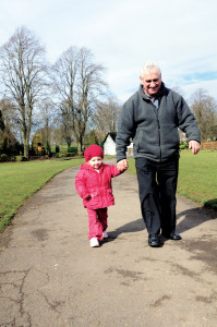 grandfather and grandaughter walking