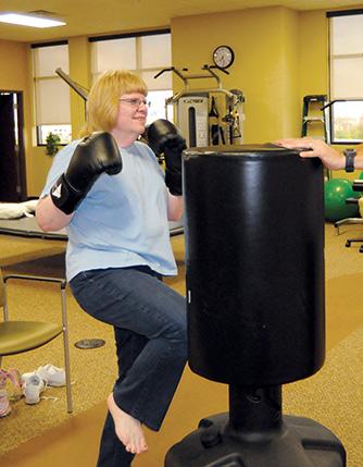 Glenda Bunn attacks the bag with her knee.