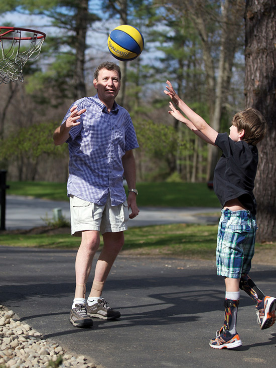 David Misener, CPO, plays basketball with his son Ethan. Both wear orthotic devices for CMT. (Photo courtesy of David Misener, CPO.)