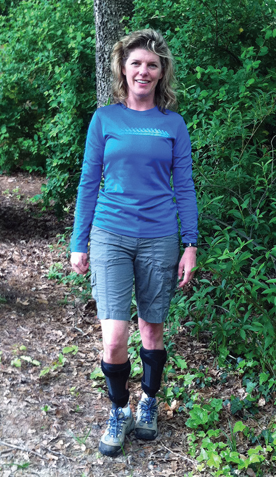 Susan Ruediger, director of development for the Charcot-Marie-Tooth Association, hikes while wearing AFOs for CMT. (Photo courtesy of Susan Ruediger.)