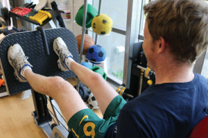 Figure 1. A teenage patient with CP performs lower body strength training. (Image courtesy of the Cerebral Palsy Alliance.)