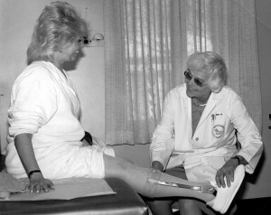 Jacquelin Perry, MD, (right) works with a polio survivor at Rancho Los Amigos Reha- bilitation Center, during the late 1980s. (Photo courtesy of Rancho Los Amigos Rehabilitation Center.)