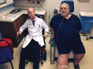 Figure 3: Armstrong gets tips on driving a motorized wheelchair from his patient Steve Frederick.