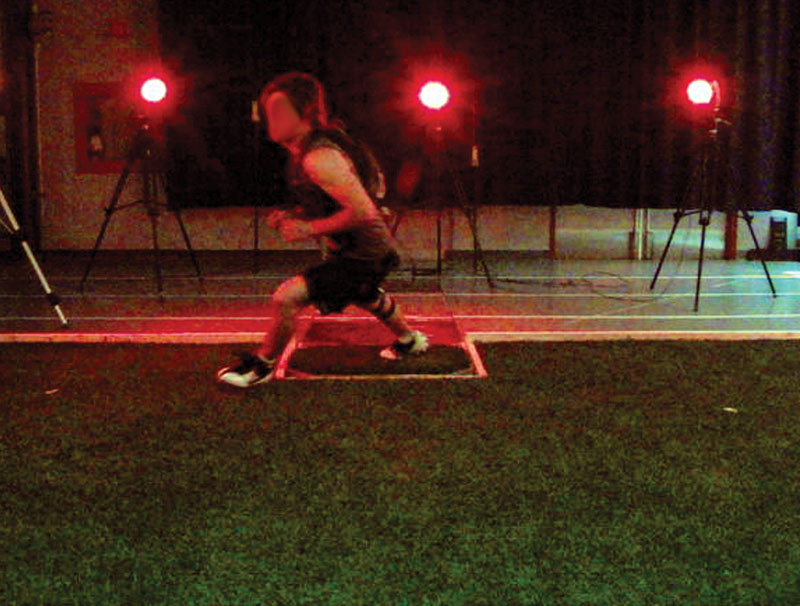 Figure 3. Athlete performing a plant-and-cut movement while the kinematics and kinetics are recorded using a motion capture system and force plate.