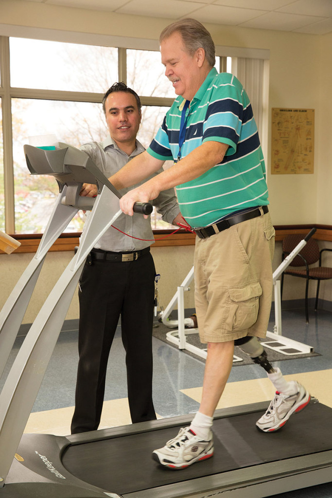 Figure 1. Adventist HealthCare Physical Health & Rehabilitation's physical therapist works with a patient during one of his outpatient therapy sessions, which are per- formed to improve physical strength, coordination and endurance after the loss of a limb. (All photos courtesy of Adventist HealthCare Physical Health & Rehabilitation.)