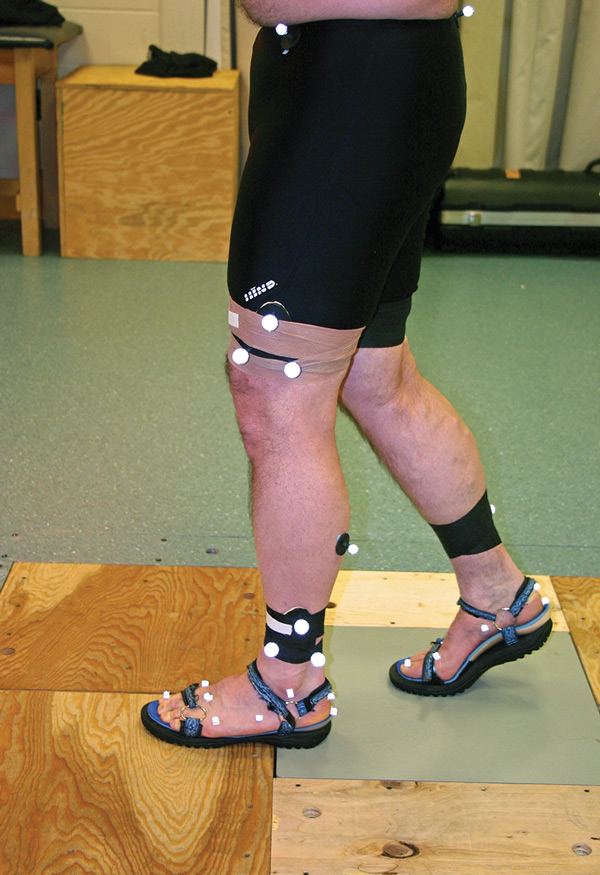 Figure 4. The retro-reflective markers, footwear, and orthoses that were used in the study.