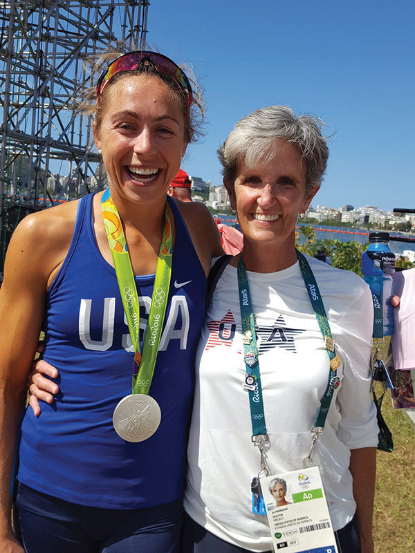 Jo A. Hannafin, MD, PhD, at the 2016 Rio Games with rowing silver medalist and future orthopedic surgeon Gevvie Stone, MD.